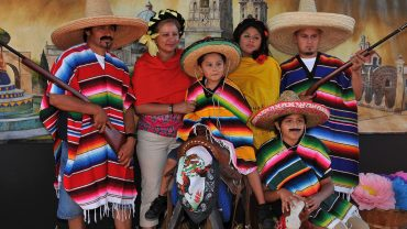 a mexican family wearing mexican costume