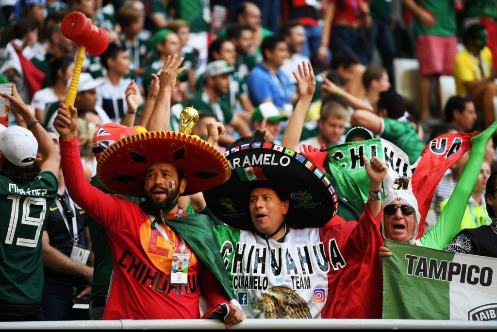 mexican fans in the audience cheering for their team