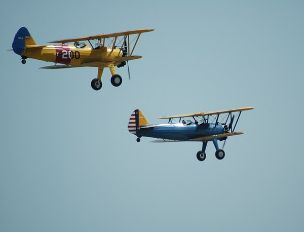 two biplanes flying together
