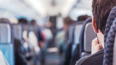 male passenger on a plane