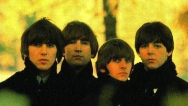 the beatles band wearing black clothes